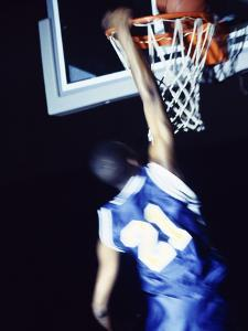 Rear View of a Teenage Boy Playing Basketball