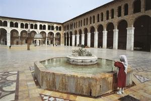 Rear View of a Woman Standing Near a Fountain in a Mosque, Umayyad Mosque, Damascus, Syria