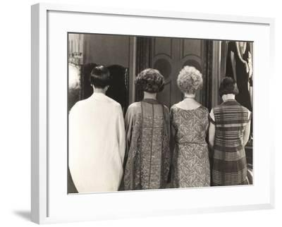 Rear View of Four Women Standing in a Row--Framed Photo