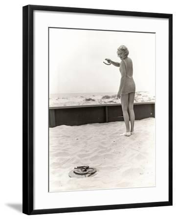 Rear View of Woman Playing Horseshoes at the Beach--Framed Photo