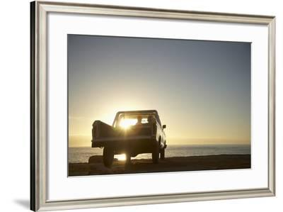 Rear View of Young Couple in Pick-Up Truck Parked in Front of Ocean Enjoying Sunset-Nosnibor137-Framed Photographic Print