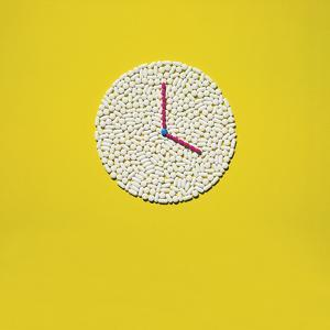 An Assortment of Pills Arranged in the Shape of a Clock by Rebecca Hale