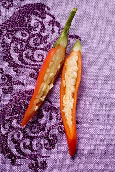 Red Chili Pepper, Halved, on Purple Fabric-Foodcollection-Photographic Print