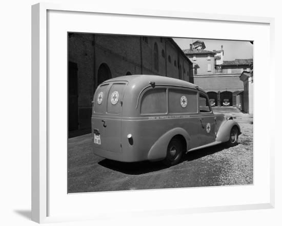 Red Cross Ambulance Parked on a Street in Bologna-A. Villani-Framed Photographic Print