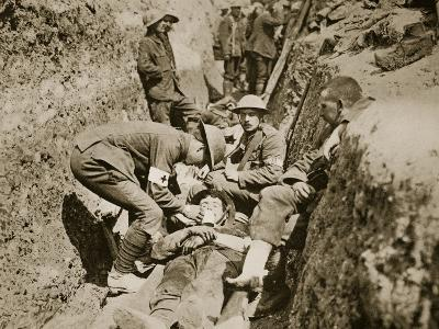 Red Cross Men in the Trenches Attending to a Wounded Man, 1916--Photographic Print