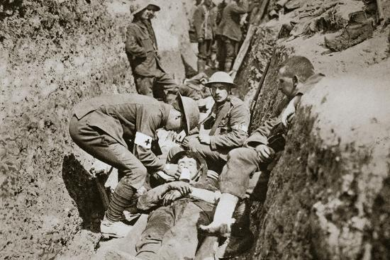 Red Cross men in the trenches tend a wounded man, Somme campaign, France, World War I, 1916-Unknown-Photographic Print