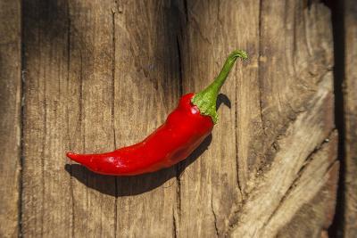 Red Pepper on Wooden Table, Yesemek, Gaziantep, Turkey-Ali Kabas-Photographic Print