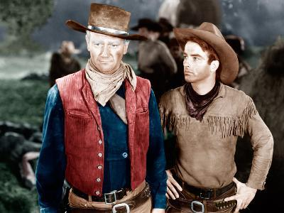 RED RIVER, from left: John Wayne, Montgomery Clift, 1948--Photo