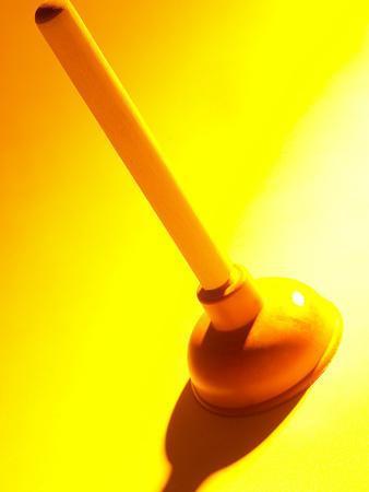 https://imgc.artprintimages.com/img/print/red-rubber-plumbing-plunger-in-yellow-light_u-l-q10x24p0.jpg?p=0