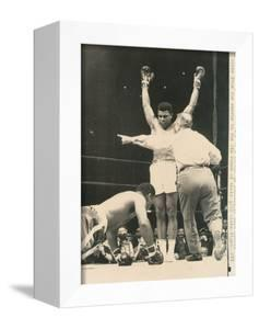 Referee John Lobianco Waves Champion Cassius Clay to a Corner