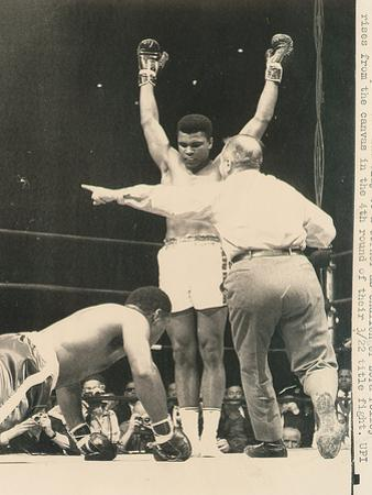 Referee John Lobianco Waves Champion Cassius Clay to a Corner