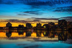 Reflection of buildings on water, Lake Merritt, Oakland, California, USA
