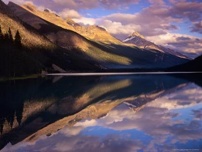 Reflection of Clouds and Mountains on Waterfoul Lake, Banff National Park, Alberta, Canada-Janis Miglavs-Photographic Print