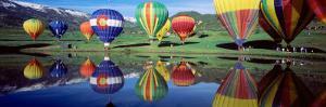 Reflection of Hot Air Balloons on Water, Colorado, USA