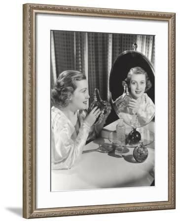 Reflection of Woman Holding Perfume Atomizer in Mirror--Framed Photo