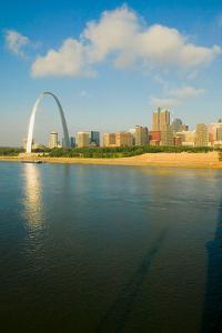 "Reflection on Gateway Arch (""Gateway to the West"") and skyline of St. Louis, Missouri at sunrise..."