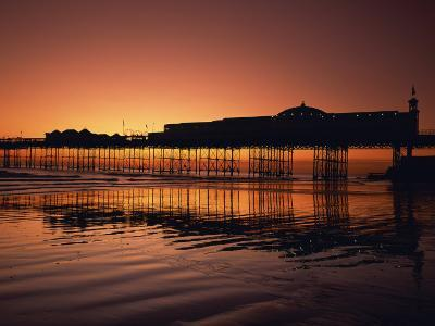 Reflections in the Sea of the Pier at Brighton at Sunset, Sussex, England, United Kingdom, Europe-Rainford Roy-Photographic Print