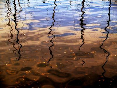 Reflections of Boat Masts in a Lake-Claire Morgan-Photographic Print