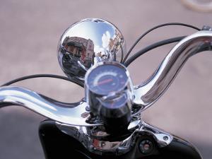 Reflective Chrome Handlebars on a Motorcycle