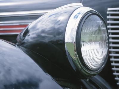 Reflective Chrome Headlight in Antique Black Car--Photographic Print