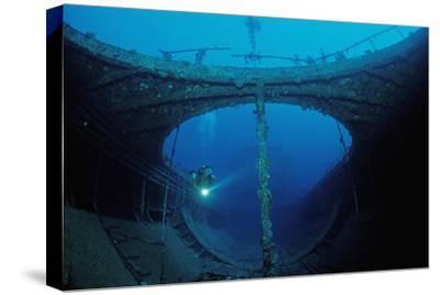 Scuba Diver Exploring a Shipwreck, Papua New Guinea, Coral Sea.