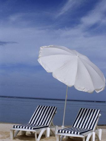 https://imgc.artprintimages.com/img/print/relaxing-beach-chairs-and-umbrella-await-customers_u-l-p88o1a0.jpg?p=0