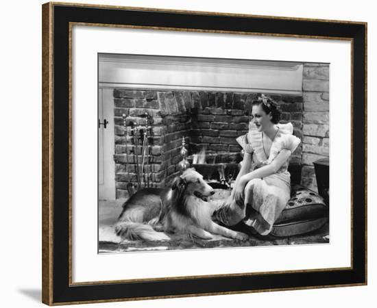 Relaxing by the Fireplace--Framed Photo