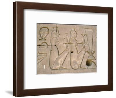 Relief on the eastern outside wall of the Sanctuary of Horus, Edfu, Egypt-Werner Forman-Framed Photographic Print