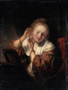 Young Woman Trying on Earrings, 1657 by Rembrandt van Rijn