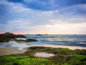 Sunset on Khao Lak Beach in Thailand by Remy Musser