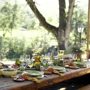 An Outdoor Table Setting with a Vegetarian Meal by Renée Comet