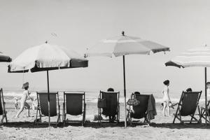 Row of Umbrellas and Chairs-Beach in Viareggio by Renzo Ferrini