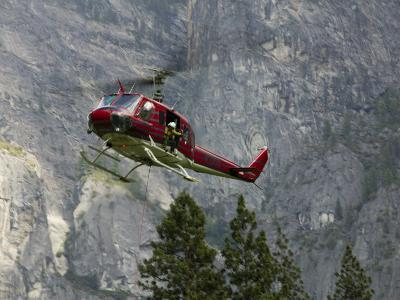 Rescue Helicopter in Front of One of Yosemite Valley's Big Walls-Brent Winebrenner-Photographic Print