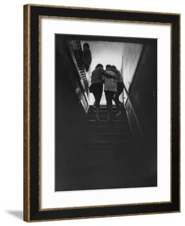 Residents Escorting a Newly Arriving Drug Addict at Synanon House for Rehabilitation--Framed Photographic Print