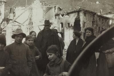 Residents of San Dona Di Piave. in the Background Buildings Destroyed by Bombing in World War I--Photographic Print