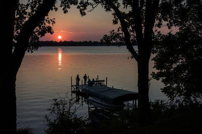 Residents Watch a Late Summer Sunset from their Dock on West Okoboji Lake-Kent Kobersteen-Photographic Print
