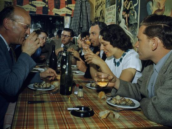 Restaurant Diners Eat Snails, Drink Wine, and Talk-Justin Locke-Photographic Print