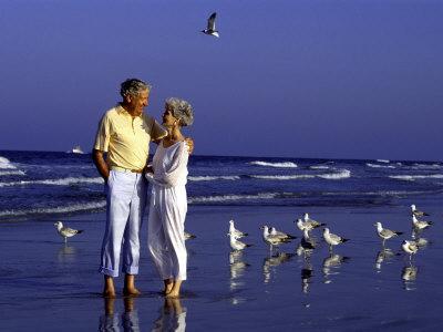 https://imgc.artprintimages.com/img/print/retired-couple-relaxing-on-the-beach_u-l-p2or980.jpg?p=0
