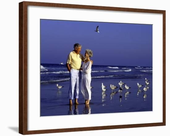 Retired Couple Relaxing on the Beach-Bill Bachmann-Framed Photographic Print
