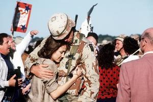Returning US Soldier Hugs Loved One Amid Other Celebrating Families and Friends