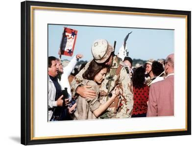 Returning US Soldier Hugs Loved One Amid Other Celebrating Families and Friends--Framed Photo