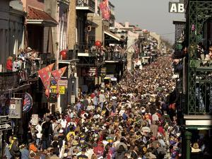 Revelers Pack the French Quarter's Famous Bourbon Street During the Annual Mardi Gras Celebration