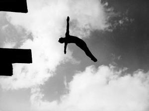 Excellent of Man Silhouetted Against Sky Doing Back Dive Off High Board by Rex Hardy Jr^