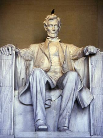 Bird Perches on Abraham Lincoln's Statue Inside the Lincoln Memorial