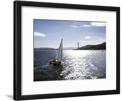 Boat Sails Toward the Golden Gate Bridge on San Francisco Bay