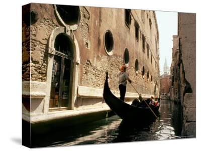 Gondolier Poles Through the Canals of Venice