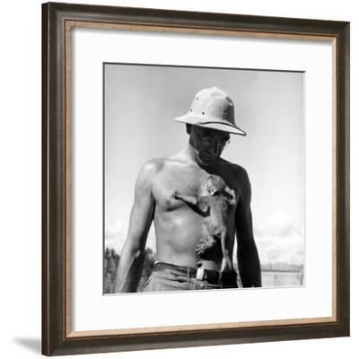 Rhesus Monkey Climbing on a Man's Chest at a Monkey Colony-Hansel Mieth-Framed Premium Photographic Print