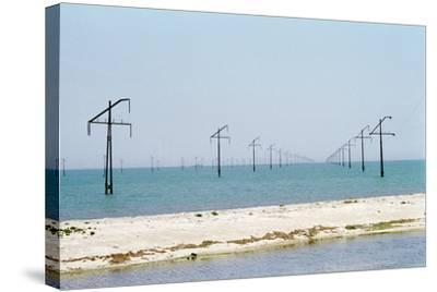 Electric Power Lines Crossing a Sea