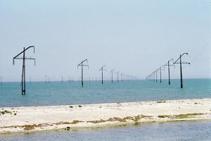 Electric Power Lines Crossing a Sea by Ria Novosti