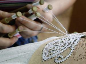 Lace Production Using Bobbins by Ria Novosti